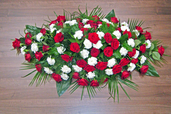 red roses white carnations casket spray