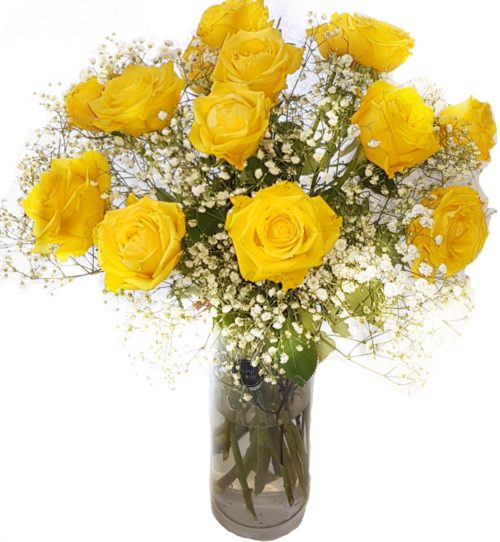 Yellow Roses with gypsophilia flower arrangement in a clear vase